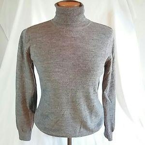 Gray wool long sleeve turtle neck. Size medium